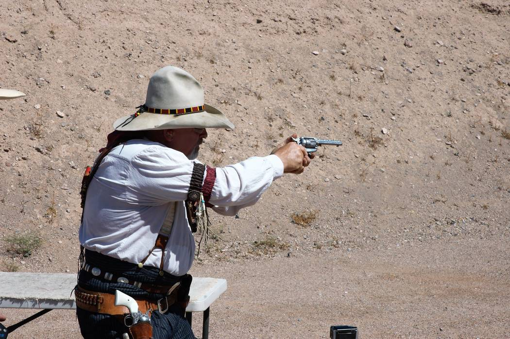 Each participant in Cowboy Action Shooting events selects and registers an alias that he or she goes by during competition. Quickly Downunder empties a pair of six-shooters rather quickly. (Doug N ...