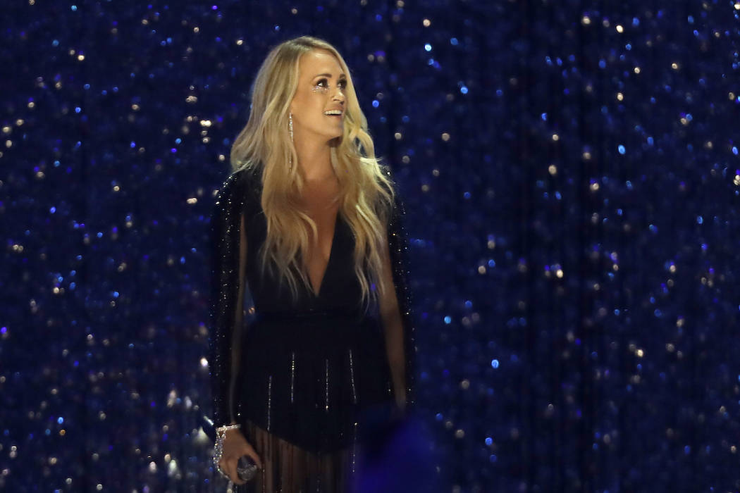 """Carrie Underwood performs """" Cry Pretty"""" at the CMT Music Awards at the Bridgestone Arena on Wednesday, June 6, 2018, in Nashville, Tenn. (AP Photo/Mark Humphrey)"""