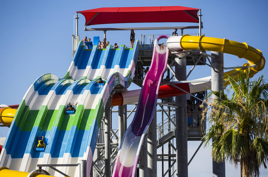 Hotel guests enjoy a large slide at the pool area at Circus Circus in Las Vegas on Friday, June 22, 2018. Chase Stevens Las Vegas Review-Journal @csstevensphoto