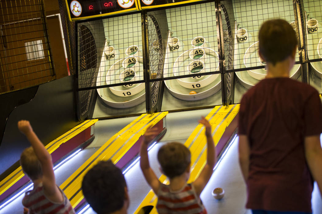 People play skee-ball at the carnival midway at Circus Circus in Las Vegas on Friday, June 22, 2018. Chase Stevens Las Vegas Review-Journal @csstevensphoto
