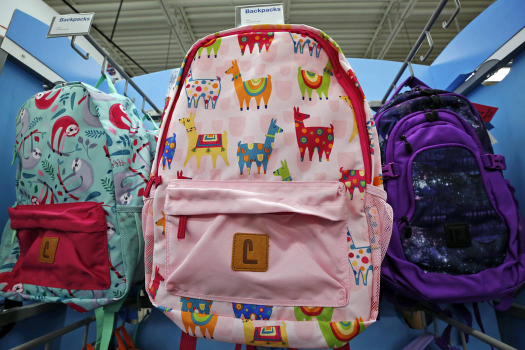 This July 18, 2018, photo shows a display of back to school backpacks in a Staples store in Pittsburgh. Llamas are in demand for decoration on backpacks and other school supplies this year. (AP Ph ...