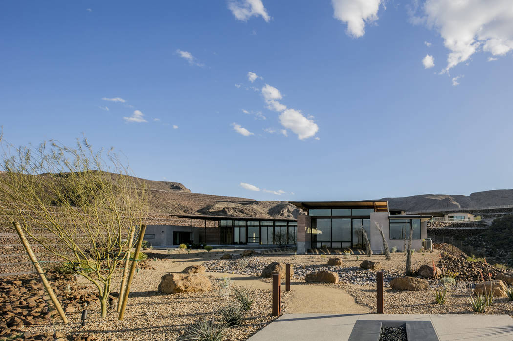 The lot's unique shape offered the designers opportunities to orient the home away from the hill's edge for privacy. (Ascaya)