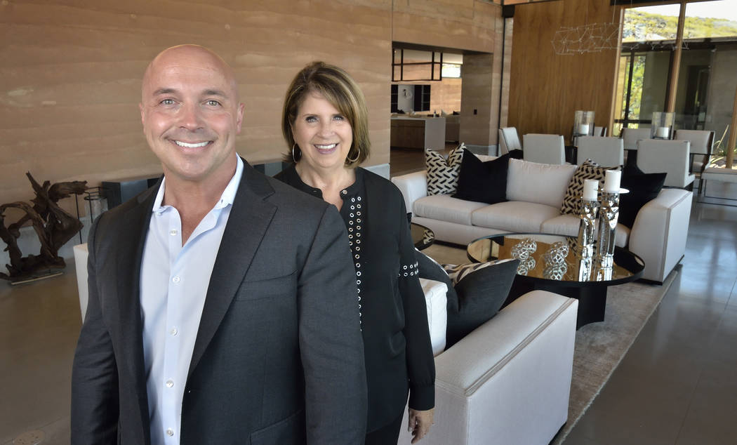 From left, Darin Marques, Ascaya sales manager, and local designer Donna Johnson, at the Inspirational Home at 5 Vista Crescent in Ascaya. (Bill Hughes Real Estate Millions)