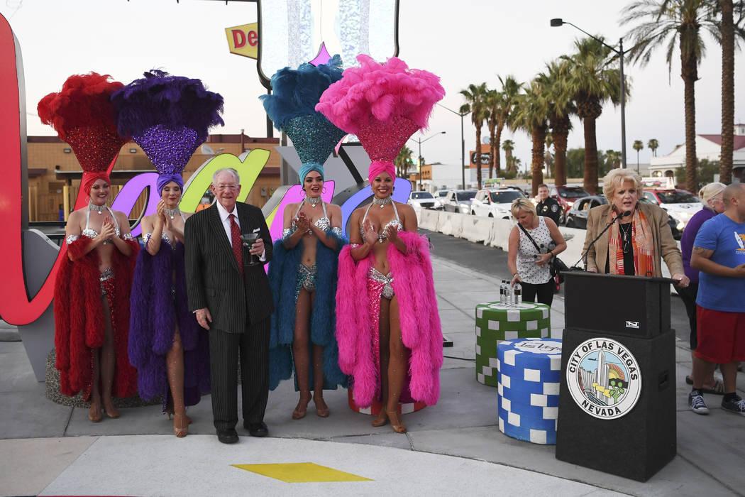 Las Vegas Mayor Carolyn Goodman speaks as LVCVA Host Committee Chairman Oscar B. Goodman poses with showgirls as a new Las Vegas gateway sign is dedicated Tuesday, August 7, 2018. (Sam Morris/Las ...
