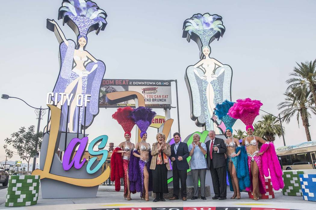 Las Vegas Mayor Carolyn Goodman, third from left, Chris Fiumara, vice president and general manager of the Stratosphere, Councilman Bob Coffin and former Las Vegas Mayor Oscar Goodman take photos ...