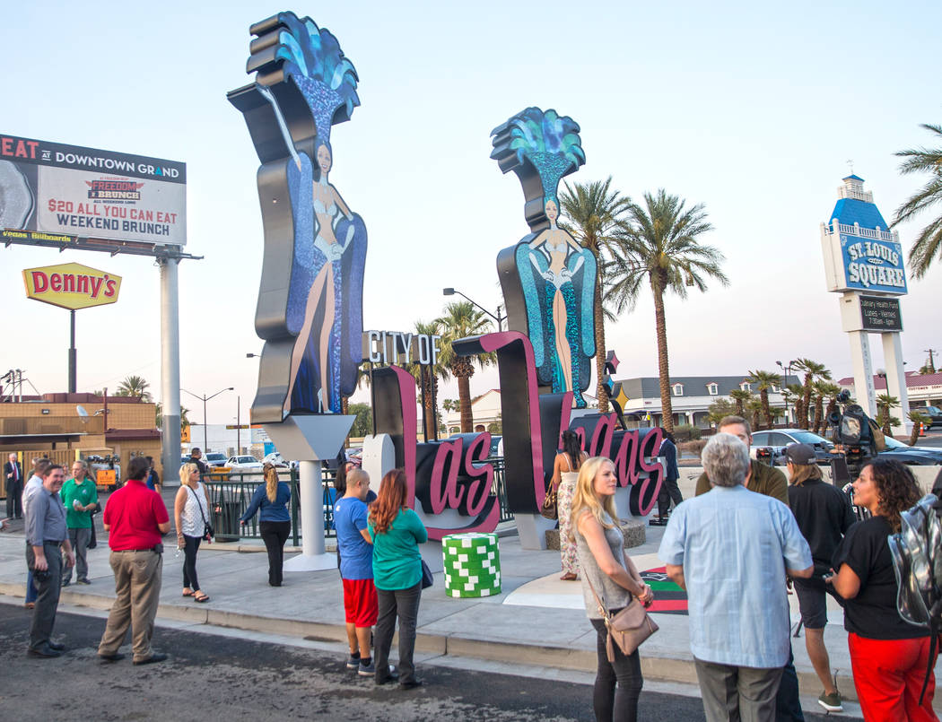 Attendees take a look at the city's new gateway sign greeting visitors heading north on Las Vegas Boulevard near the Stratosphere on Tuesday, Aug., 7, 2018, in Las Vegas. Benjamin Hager ...