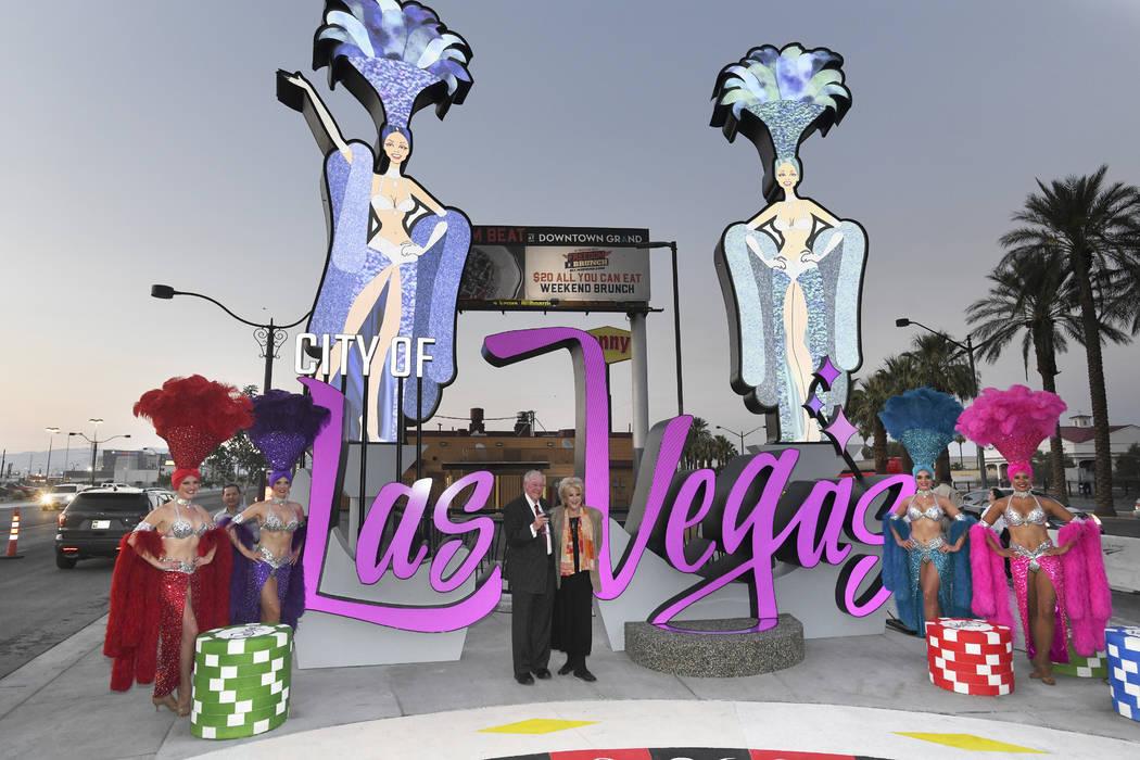 LVCVA Host Committee Chairman Oscar B. Goodman and Las Vegas Mayor Carolyn Goodman pose for photos as a new Las Vegas gateway sign is dedicated Tuesday, August 7, 2018. (Sam Morris/Las Vegas News ...