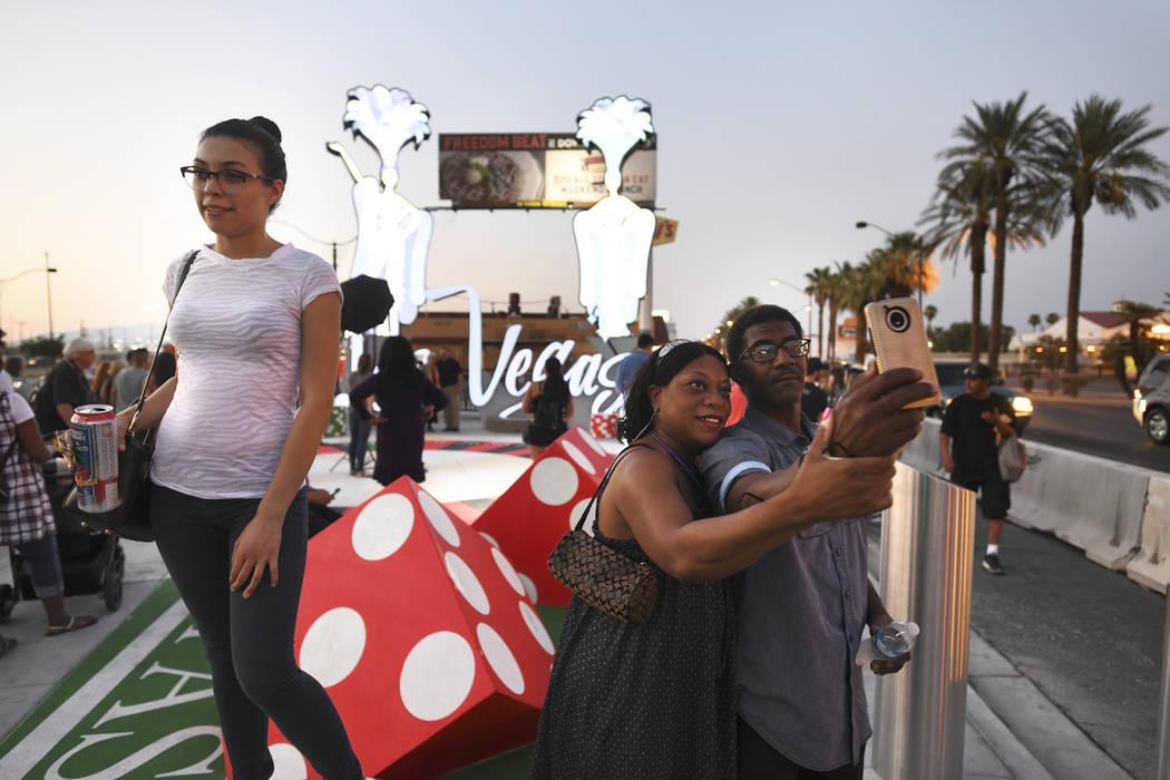 Bystanders take selfies and photos as a new Las Vegas gateway sign is dedicated Tuesday, August 7, 2018. (Sam Morris/Las Vegas News Bureau)
