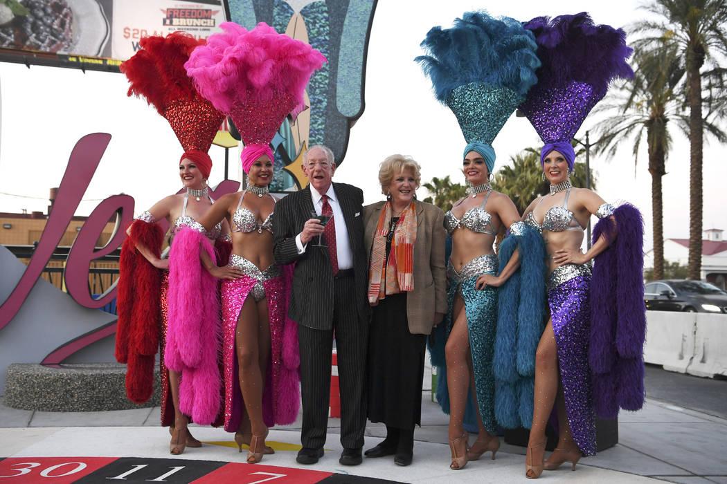 LVCVA Host Committee Chairman Oscar B. Goodman and Las Vegas Mayor Carolyn Goodman pose with showgirls as a new Las Vegas gateway sign is dedicated Tuesday, August 7, 2018. (Sam Morris/Las Vegas N ...
