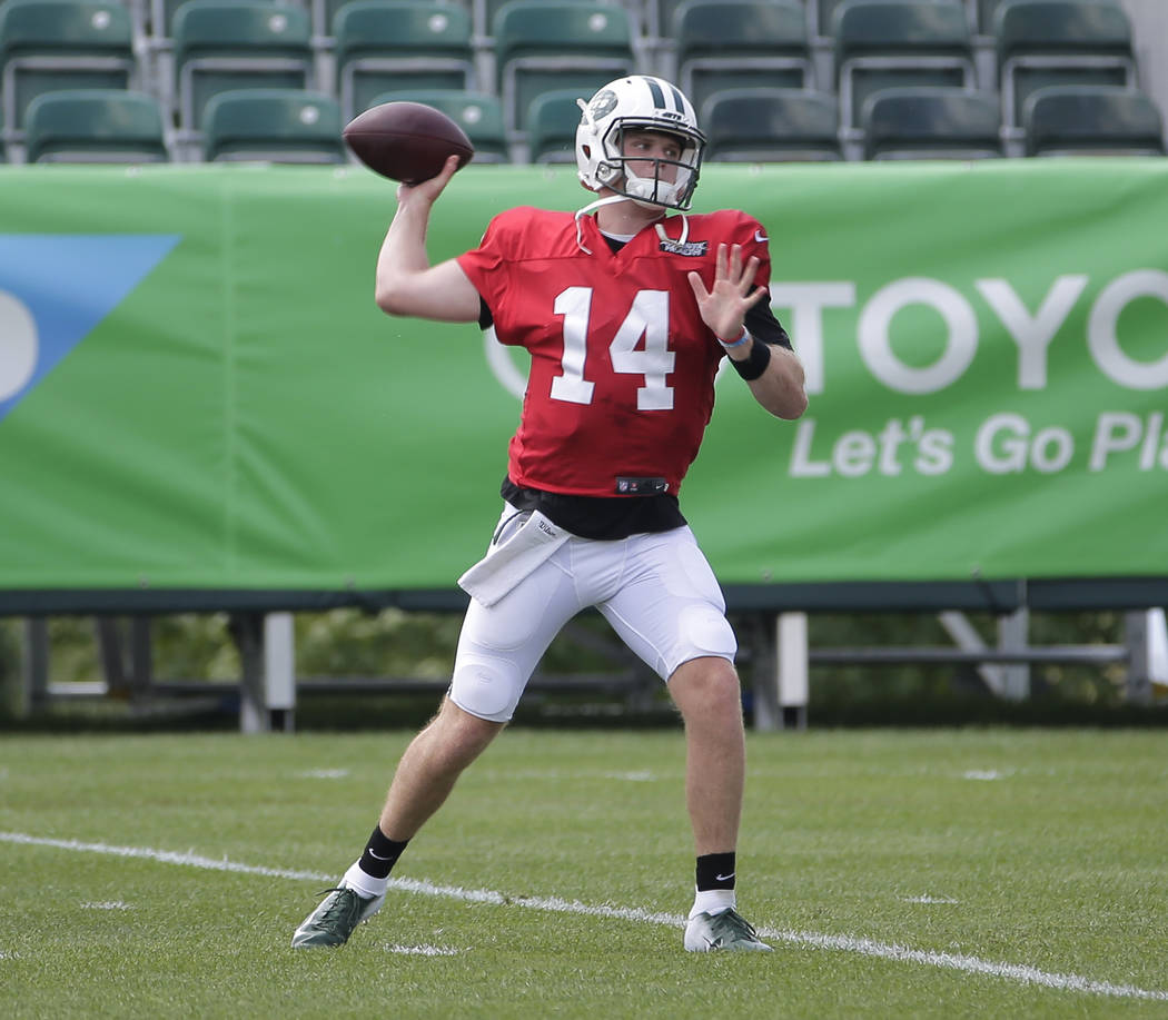 New York Jets quarterback Sam Darnold throws during practice at the NFL football team's training camp in Florham Park, N.J., Monday, Aug. 6, 2018. (AP Photo/Seth Wenig)