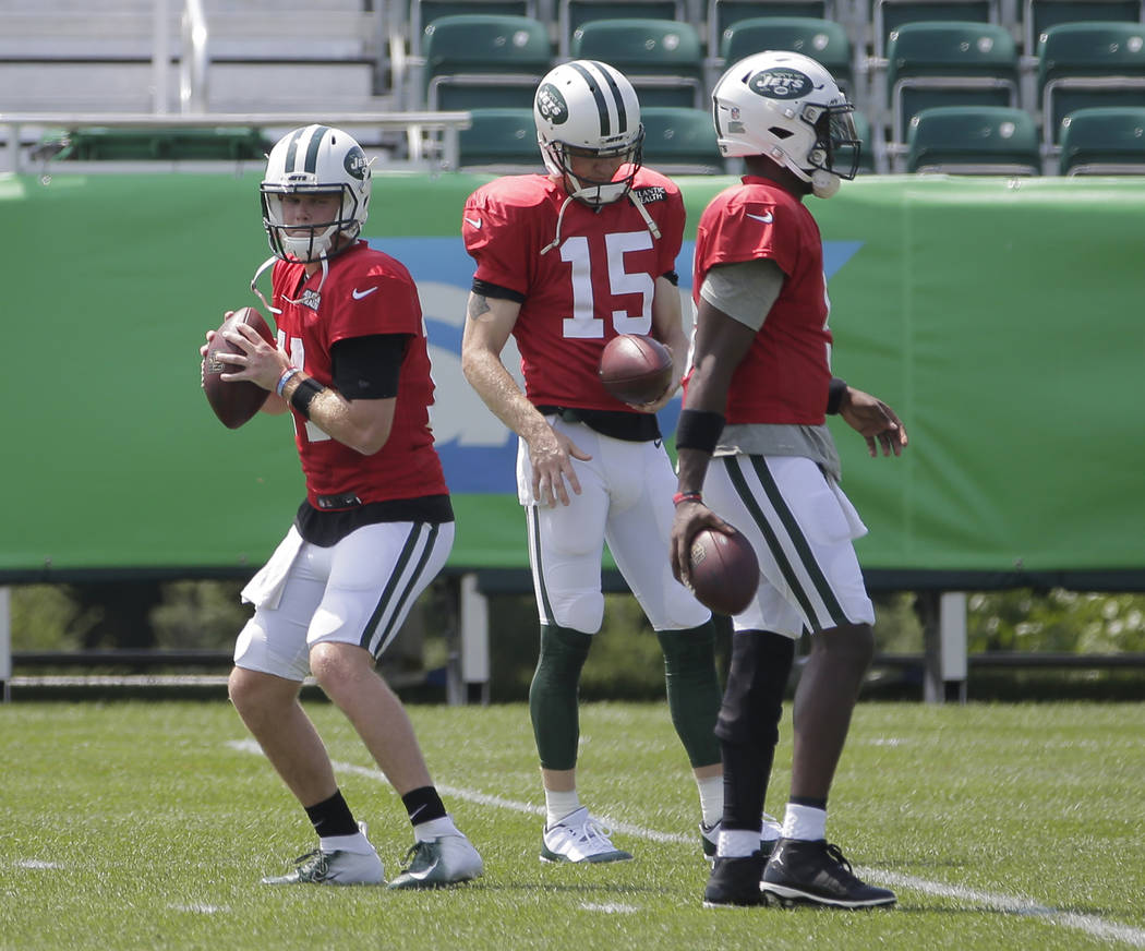 New York Jets quarterbacks Sam Darnold, left, Teddy Bridgewater, right, and Josh McCown participate during practice at the NFL football team's training camp in Florham Park, N.J., Monday, Aug. 6, ...