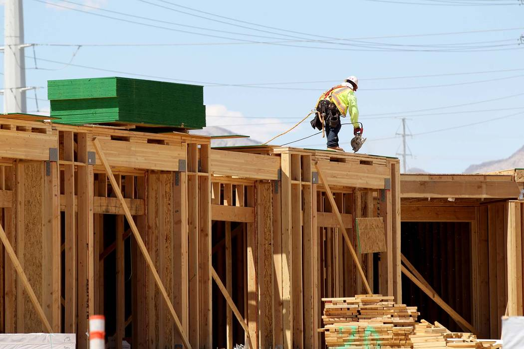 A crew works on a town home project. A report by Home Builders Research says Las Vegas homebuilders are building more attached home products to provide more affordable options. (K.M. Cannon RJNewH ...