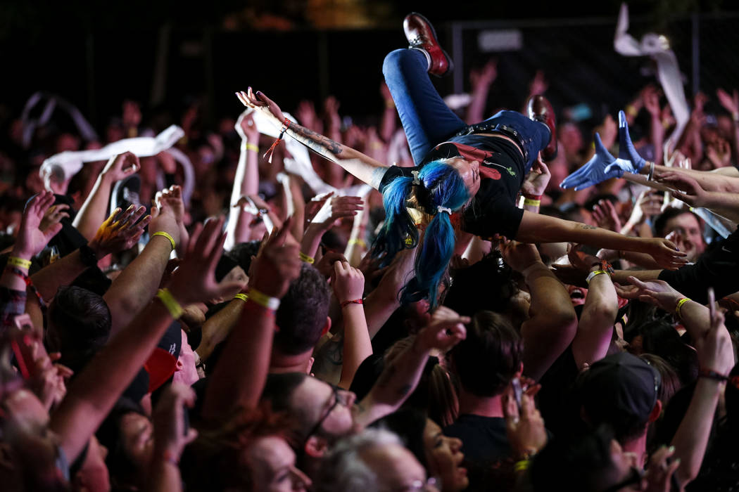 A festival-goer crowd surfs as A Day to Remember performs on day one of the second annual Las Rageous rock festival at the Downtown Las Vegas Events Center on Friday, April 20, 2018. Richard Brian ...