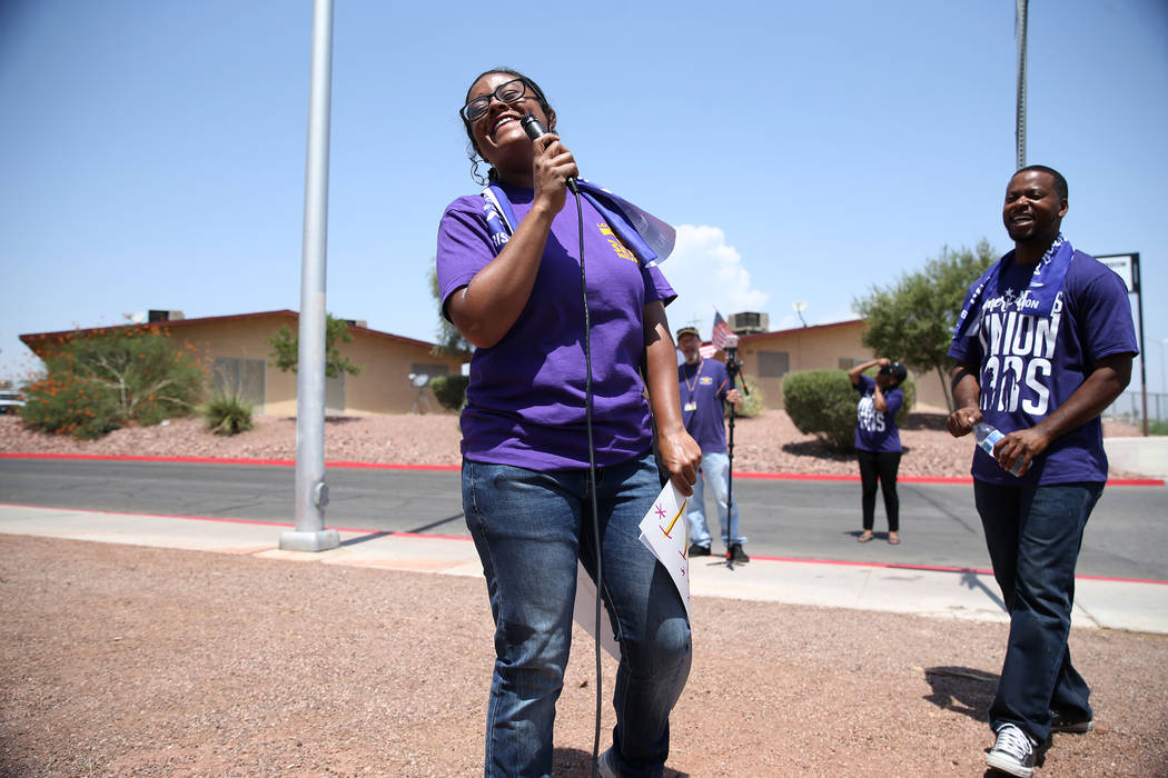 Union member Roxana Valladares, left, with Assemblyman William McCurdy II, rally the crowd during a protest by the Service Employees International Union (SEIU) Nevada Local 1107 outside of the Sou ...