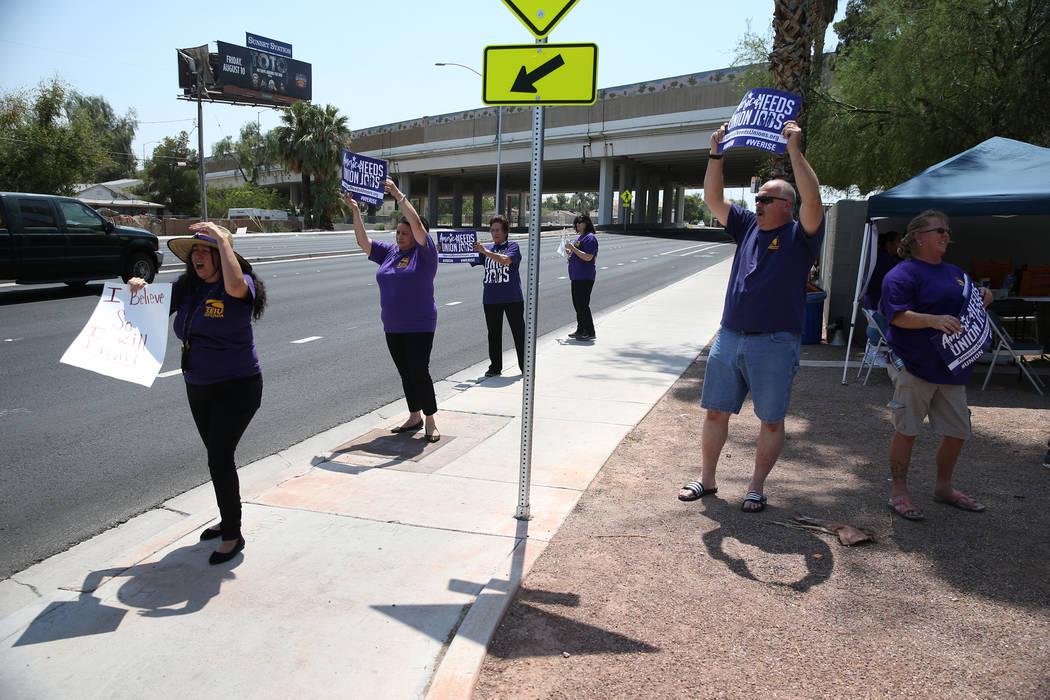 Service Employees International Union (SEIU) Nevada Local 1107 members, protest the Southern Nevada Regional Housing Authority, 380 N. Maryland Parkway, in Las Vegas, Wednesday, Aug. 8, 2018. Erik ...