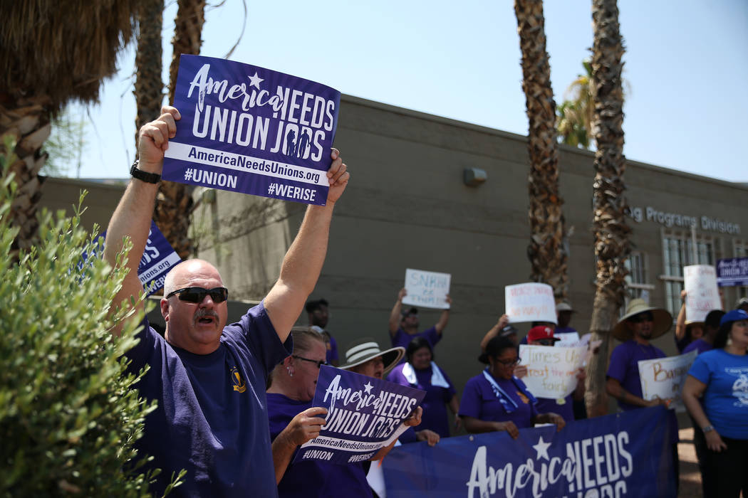 David Sizemore, union member and building engineer with the Las Vegas Convention and Visitors Authority, participates during a protest by the Service Employees International Union (SEIU) Nevada Lo ...