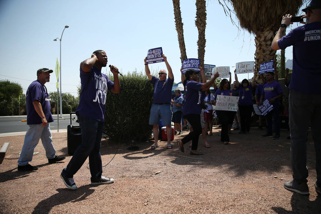 Assemblyman William McCurdy II rallies the crowd during a protest by the Service Employees International Union (SEIU) Nevada Local 1107 outside of the Southern Nevada Regional Housing Authority, 3 ...