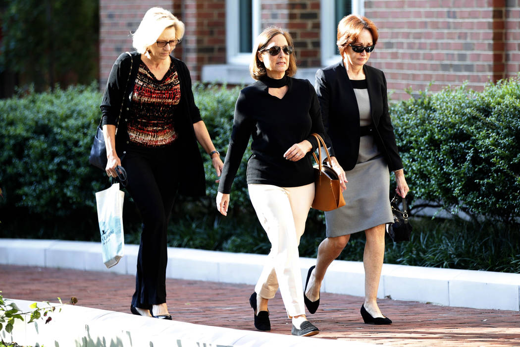 Kathleen Manafort, right, wife of former Trump campaign chairman Paul Manafort, arrives at federal court to attend the trial of her husband in Alexandria, Va., Wednesday, Aug. 8, 2018. (Jacquelyn ...
