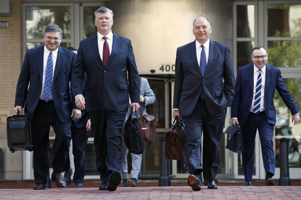 The defense team for Paul Manafort, including Kevin Downing, front left, and Thomas Zehnle, front right, arrive at federal court for the continuation of the trial of the former Trump campaign chai ...