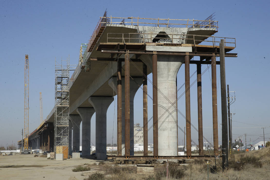 In this Wednesday, Dec. 6, 2017 file photo, is one of the elevated sections of the high-speed rail under construction in Fresno, Calif. (AP Photo/Rich Pedroncelli, file)