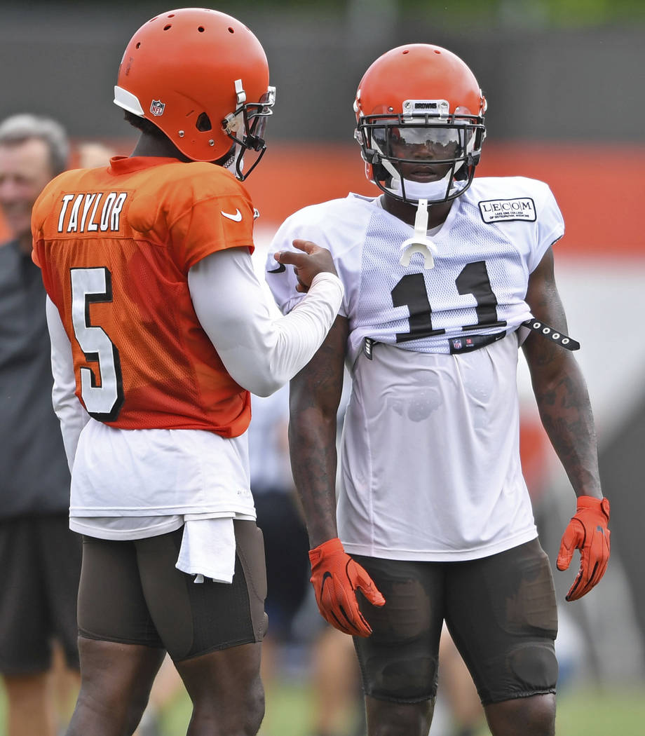 Cleveland Browns wide receiver Antonio Callaway, right, talks with quarterback Tyrod Taylor during NFL football training camp, Tuesday, Aug. 7, 2018, in Berea, Ohio. Callaway was cited for marijua ...