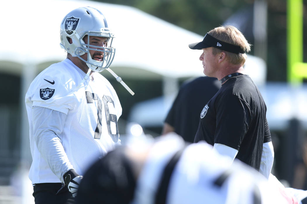 Oakland Raiders offensive guard Jon Feliciano (76) speaks with head coach Jon Gruden at the team's NFL training camp in Napa, Calif., Friday, July 27, 2018. Heidi Fang Las Vegas Review-Journal @He ...