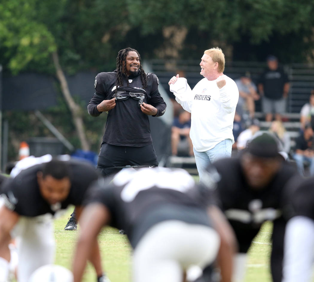 Oakland Raiders running back Marshawn Lynch (24) and owner Mark Davis engage in a conversation at the team's NFL training camp in Napa, Calif., Wednesday, Aug. 8, 2018. Heidi Fang Las Vegas Review ...