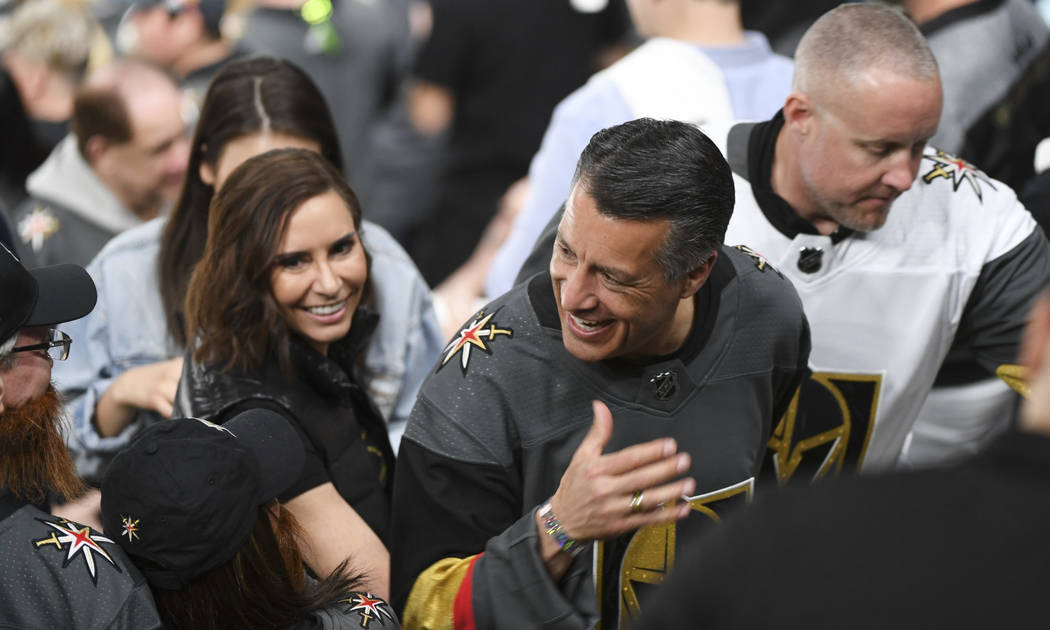 Nevada Governor Brian Sandoval and fiancee Lauralyn McCarthy is greeted as he heads to the concourse between the second and third periods of Game 2 of a NHL hockey first-round playoff series betwe ...