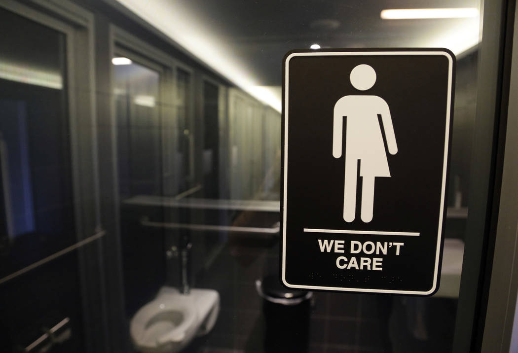 """Signage hangs outside a restroom at 21c Museum Hotel in Durham, N.C. Transgender plaintiffs who think the compromise that replaced North Carolina's """"bathroom bill"""" is still discriminatory are head ..."""