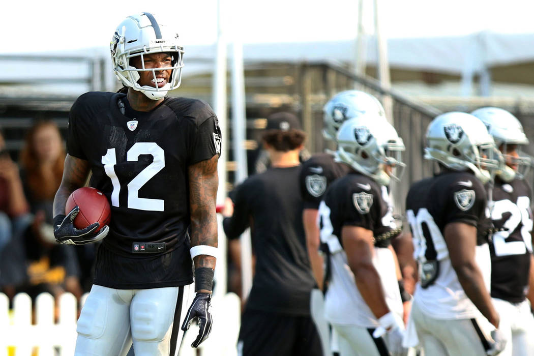 Oakland Raiders wide receiver Martavis Bryant (12) holds on to a football at the team's NFL training camp in Napa, Calif., Tuesday, Aug. 7, 2018. Heidi Fang Las Vegas Review-Journal @HeidiFang
