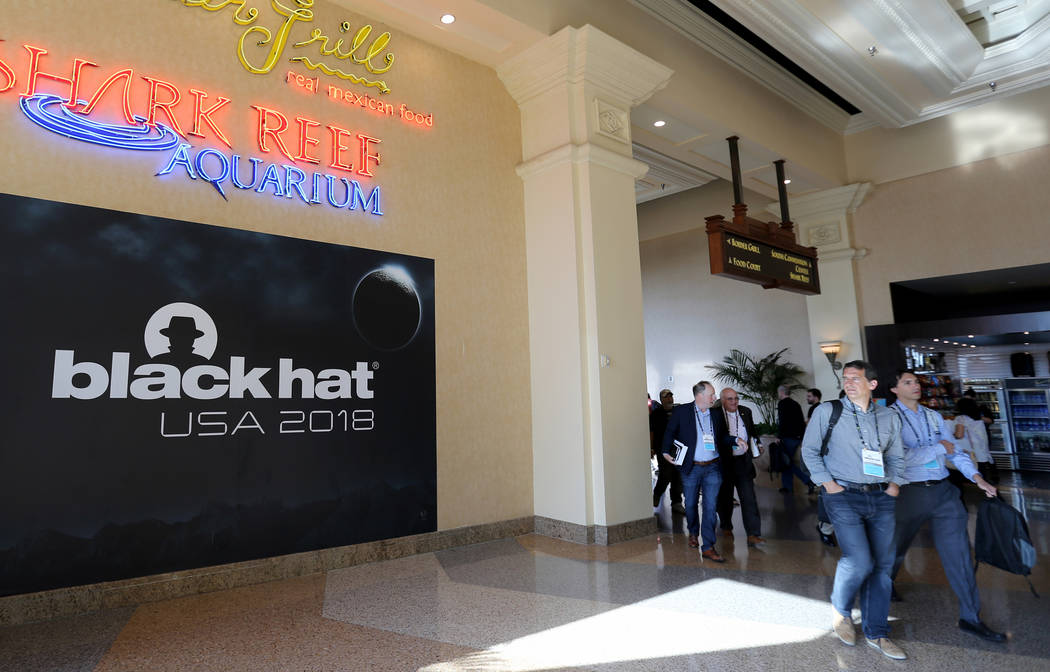 Conventioneers arrive at Black Hat USA cybersecurity conference at Mandalay Bay in Las Vegas Wednesday, Aug. 8, 2018. K.M. Cannon Las Vegas Review-Journal @KMCannonPhoto