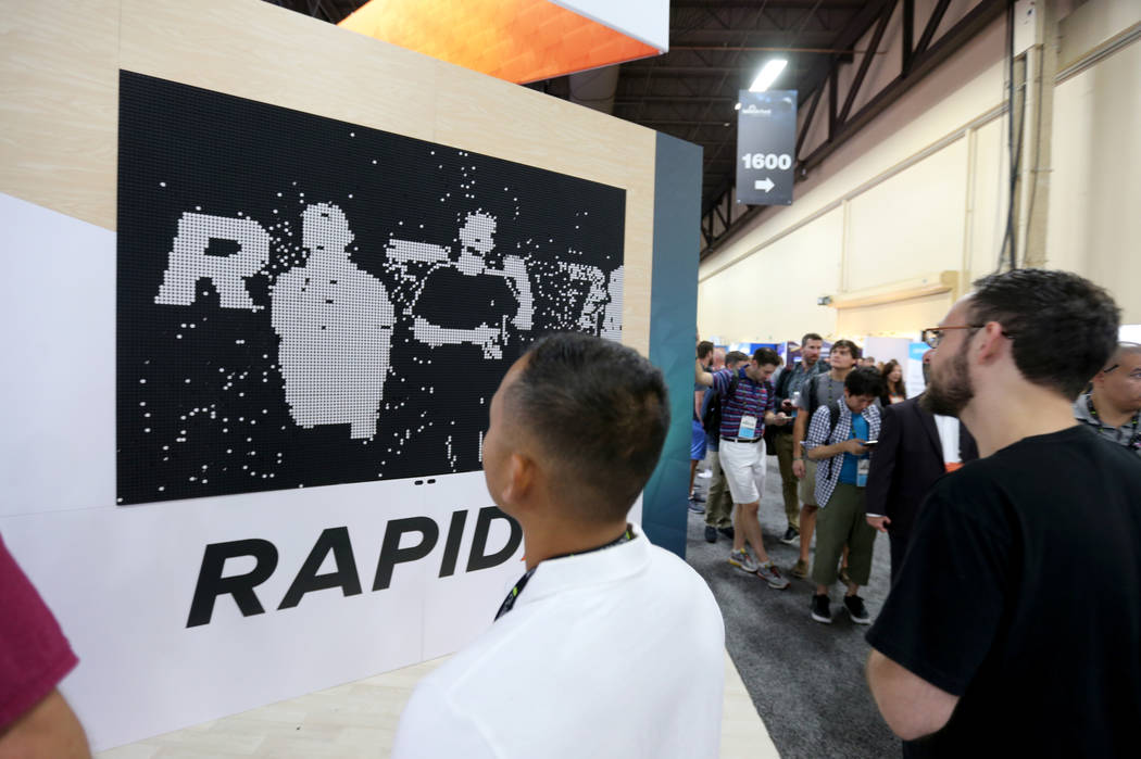 Conventioneers check out the Rapid7 booth at Black Hat USA cybersecurity conference at Mandalay Bay in Las Vegas Wednesday, Aug. 8, 2018. K.M. Cannon Las Vegas Review-Journal @KMCannonPhoto