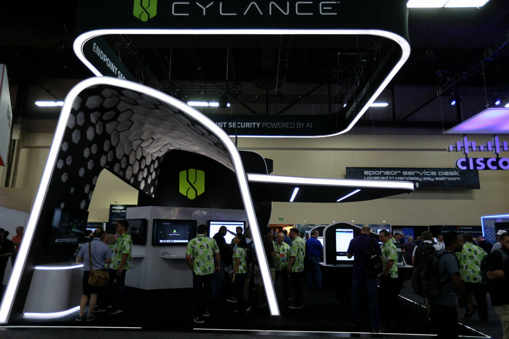 Conventioneers check out the Cylance booth at Black Hat USA cybersecurity conference at Mandalay Bay in Las Vegas Wednesday, Aug. 8, 2018. K.M. Cannon Las Vegas Review-Journal @KMCannonPhoto