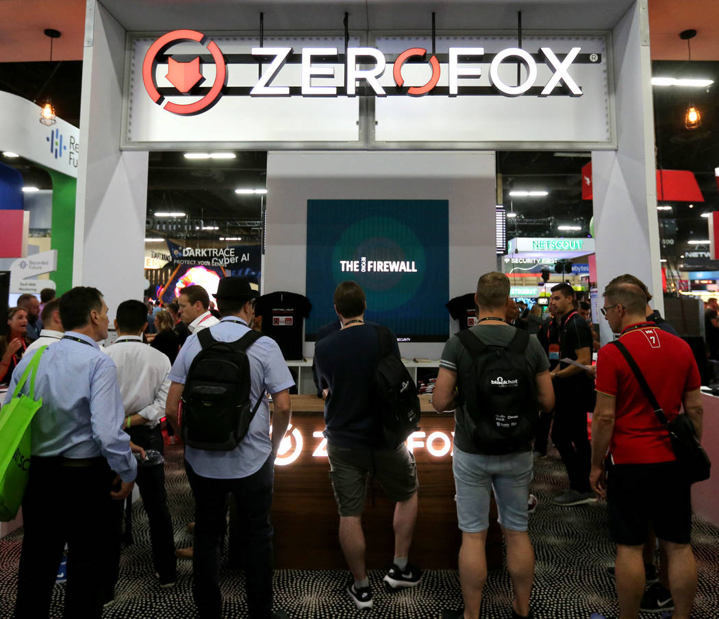 Conventioneers check out the ZeroFOX booth at Black Hat USA cybersecurity conference at Mandalay Bay in Las Vegas Wednesday, Aug. 8, 2018. K.M. Cannon Las Vegas Review-Journal @KMCannonPhoto