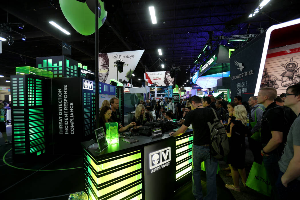 Conventioneers check out the AlienVault booth at Black Hat USA cybersecurity conference at Mandalay Bay in Las Vegas Wednesday, Aug. 8, 2018. K.M. Cannon Las Vegas Review-Journal @KMCannonPhoto
