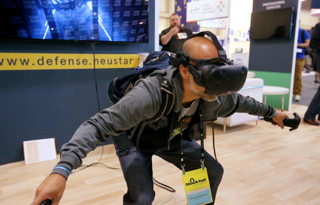 Marc-Andre Drapeau plays a virtual reality game at the Neustar booth at Black Hat USA cybersecurity conference at Mandalay Bay in Las Vegas Wednesday, Aug. 8, 2018. K.M. Cannon Las Vegas Review-Jo ...