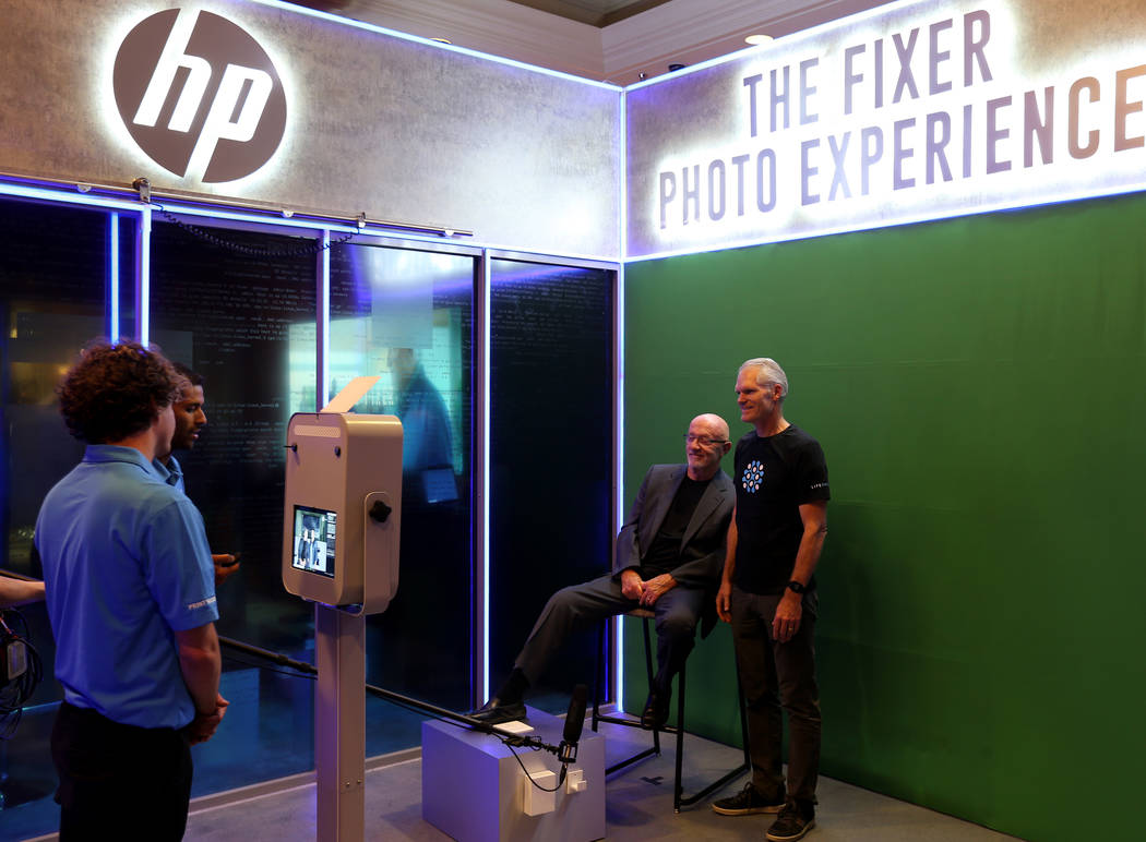 David Fuller of Salt Lake City, right, poses with actor Jonathan Banks at the HP booth at Black Hat USA cybersecurity conference at Mandalay Bay in Las Vegas Wednesday, Aug. 8, 2018. K.M. Cannon L ...