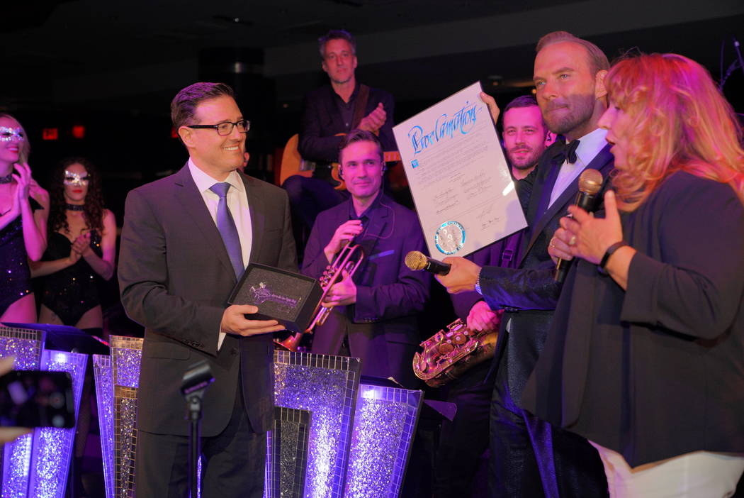 Mirage General Manager Franz Kallao, Matt Goss and Clark County Commissioner Marilyn Kirkpatrick present Matt Goss with a proclamation for Aug. 8 as Matt Goss Day in Clark County and a Key to the ...