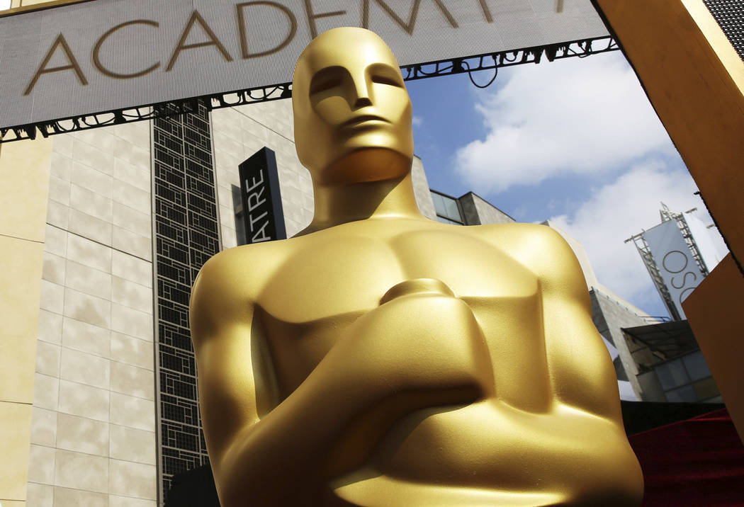 In this Feb. 21, 2015 file photo, an Oscar statue appears outside the Dolby Theatre for the 87th Academy Awards in Los Angeles. The Oscars are adding a new category to honor popular films and prom ...