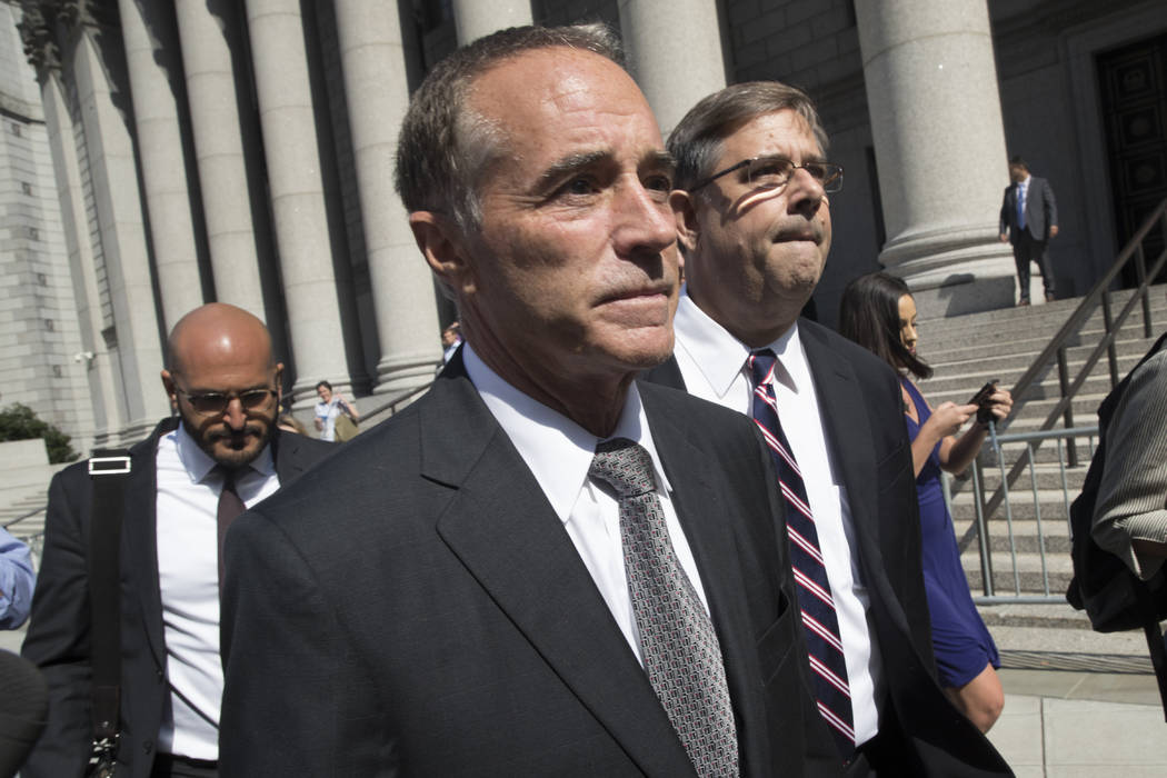 Republican U.S. Rep. Christopher Collins, center, leaves federal court, Wednesday, Aug. 8, 2018, in New York. Rep. Collins of western New York state has been indicted on charges that he used insid ...