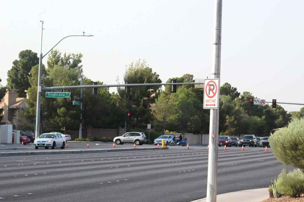 Durango Drive between Tropicana Avenue and Peace Way in western Las Vegas is shut down as police investigate an injury rollover crash, Thursday, Aug. 9, 2018. (Max Michor/Las Vegas Review-Journal)