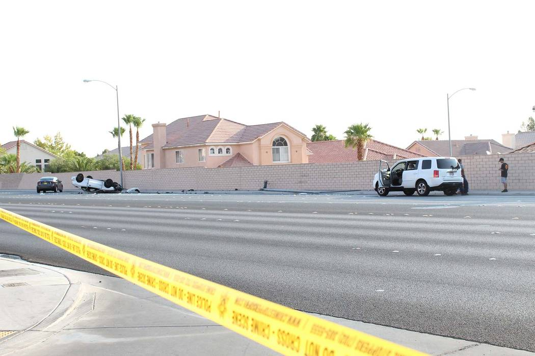 Las Vegas police say one person was injured in a rollover crash on Durango Drive, between Tropicana Avenue and Peace Way, in western Las Vegas, Thursday, Aug. 9, 2018. (Max Michor/Las Vegas Review ...