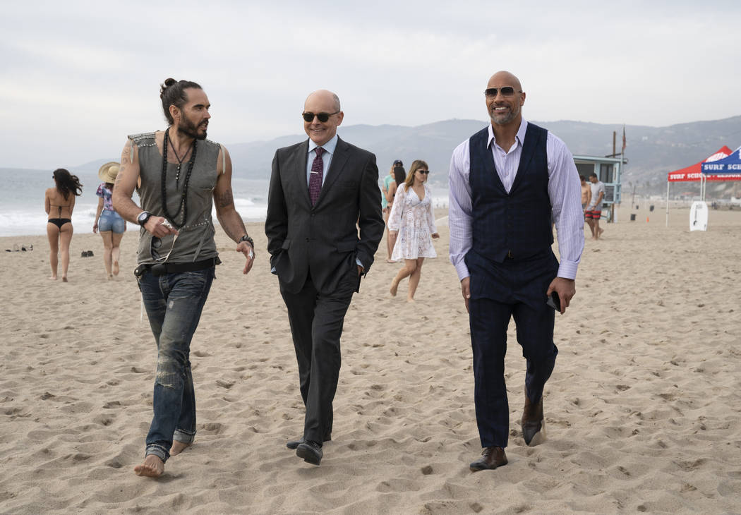 "From left, Russell Brand, Rob Corddry and Dwayne Johnson appear in a scene from ""Ballers."" (Jeff Daly/HBO)"