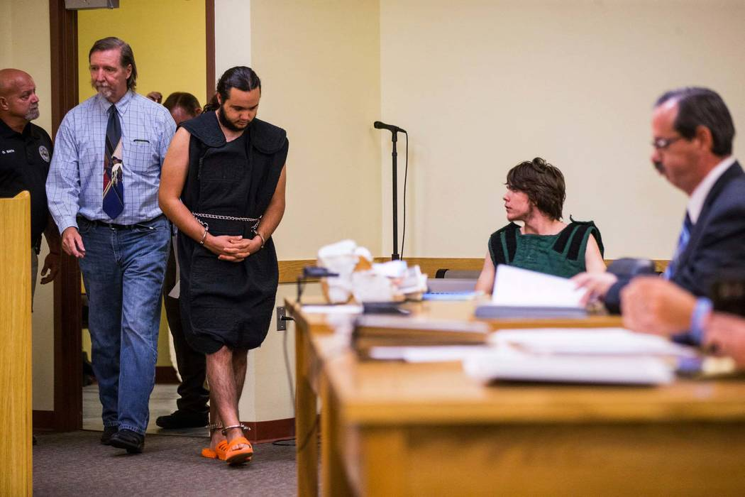 A shackled Dakota Saldivar enters the courtroom while his brother, Michael Wilson, sits at a table in Pahrump Justice Court on Thursday, Aug. 9, 2018. The 17-year-olds were in court for an arraign ...