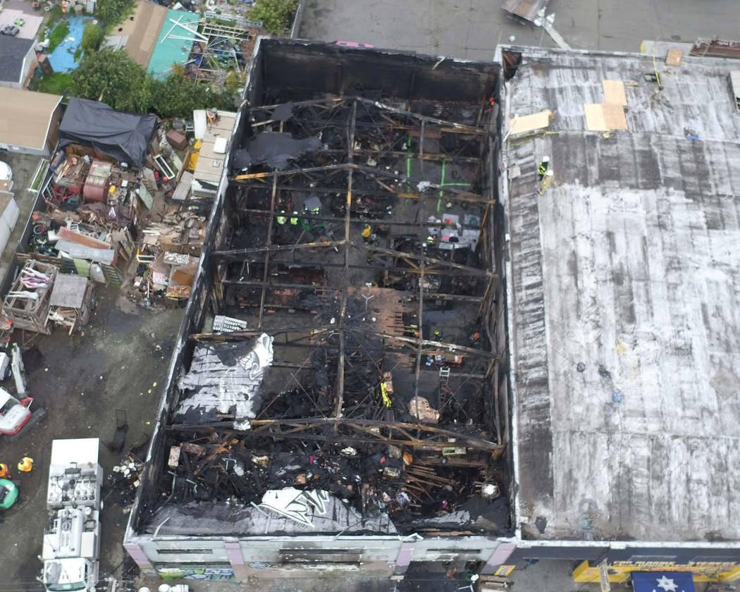This undated file photo provided by the City of Oakland shows inside the burned warehouse after the deadly fire that broke out on Dec. 2, 2016, in Oakland, Calif. (City of Oakland via AP, File)