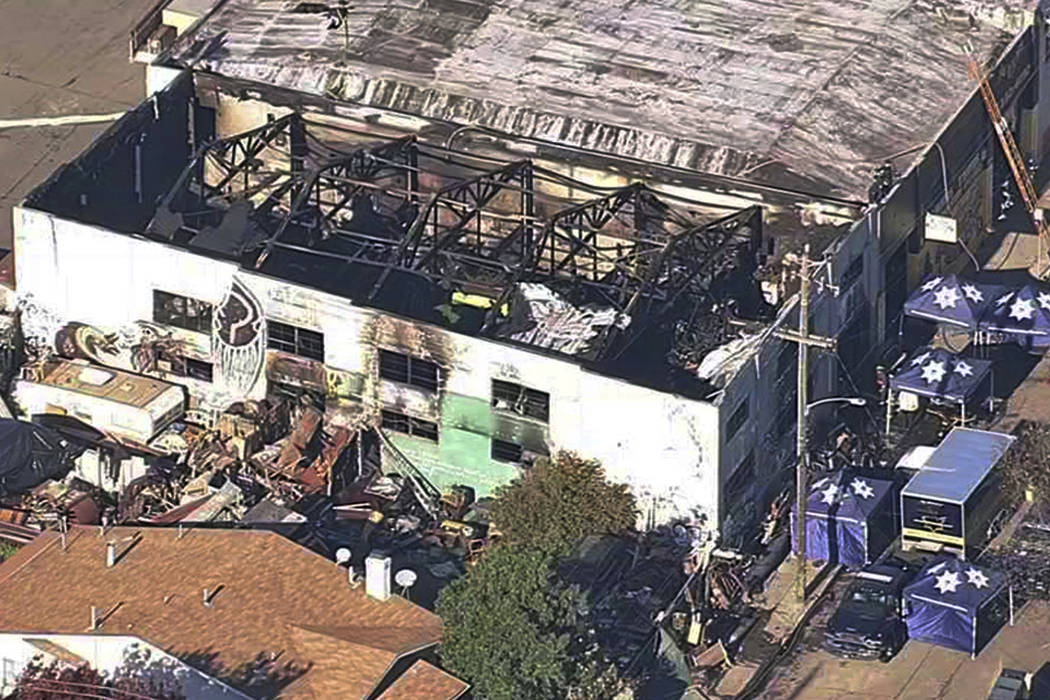 The Ghost Ship Warehouse after a fire swept through the building in Oakland, Calif. on Dec. 3, 2016. (KGO-TV via AP, File)