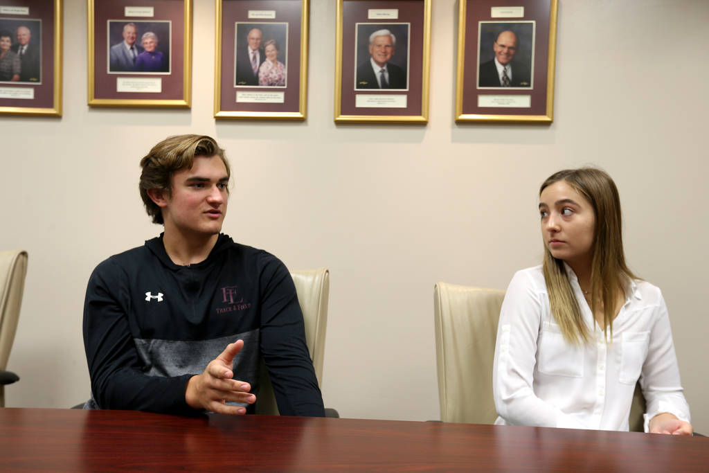 Senior Zac McPherson, 17, and graduate Lauren Carter, 18, talk about the Williams Research Greenhouse at Faith Lutheran Middle School and High School in Las Vegas Friday, Aug. 10, 2018. K.M. Canno ...