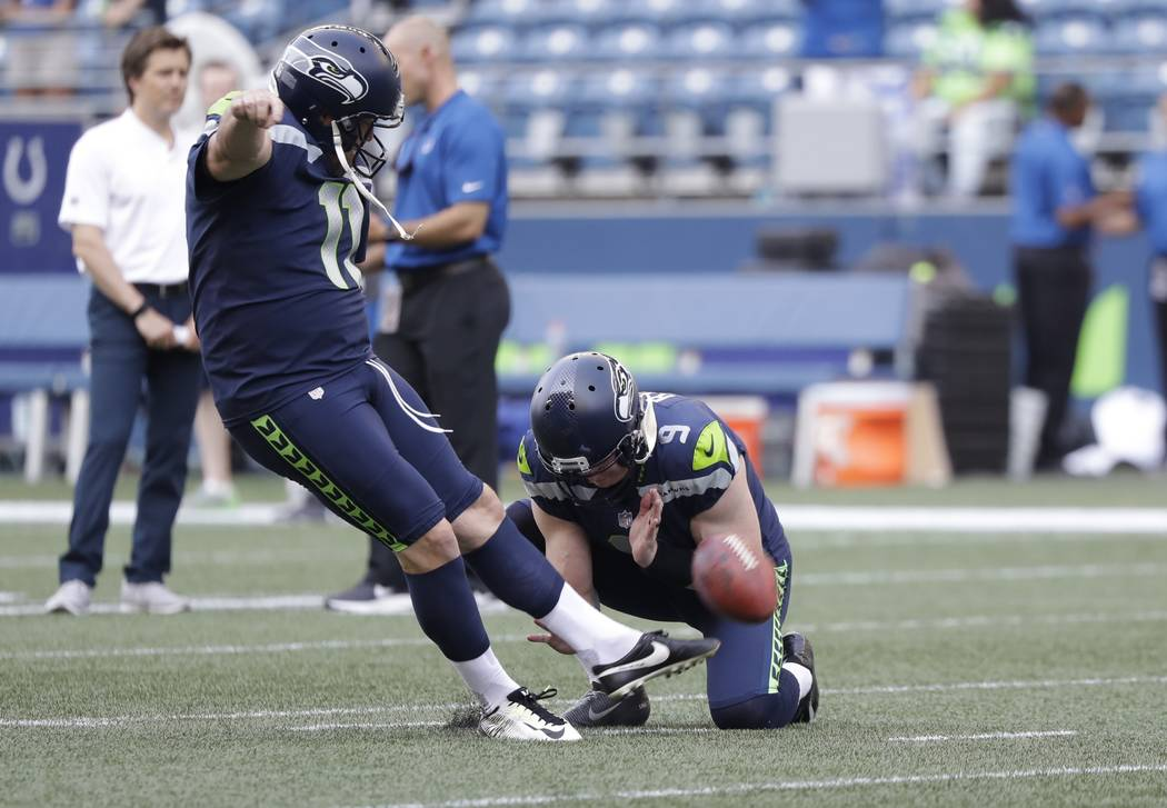 Seattle Seahawks kicker Sebastian Janikowski (11) kicks as punter Jon Ryan  holds during warmups 65a29a237