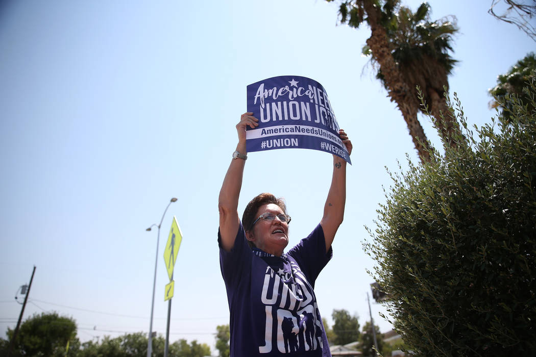 Union organizer Susan Smith participates during a protest by the Service Employees International Union (SEIU) Nevada Local 1107 outside of the Southern Nevada Regional Housing Authority, 380 N. Ma ...