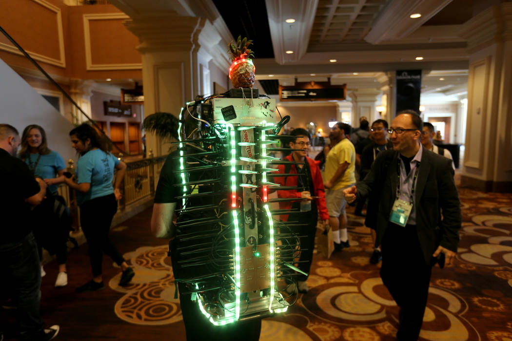 """Mike Spicer of Cedar City, Utah, with Initec wireless security, monitors 50 channels of Wi-Fi using what he called the """"Hashtag Wi-Fi Cactus"""" at Black Hat USA cybersecurity conference at ..."""